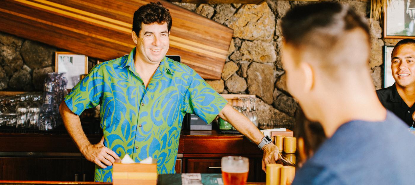 Bartender smiling at guest