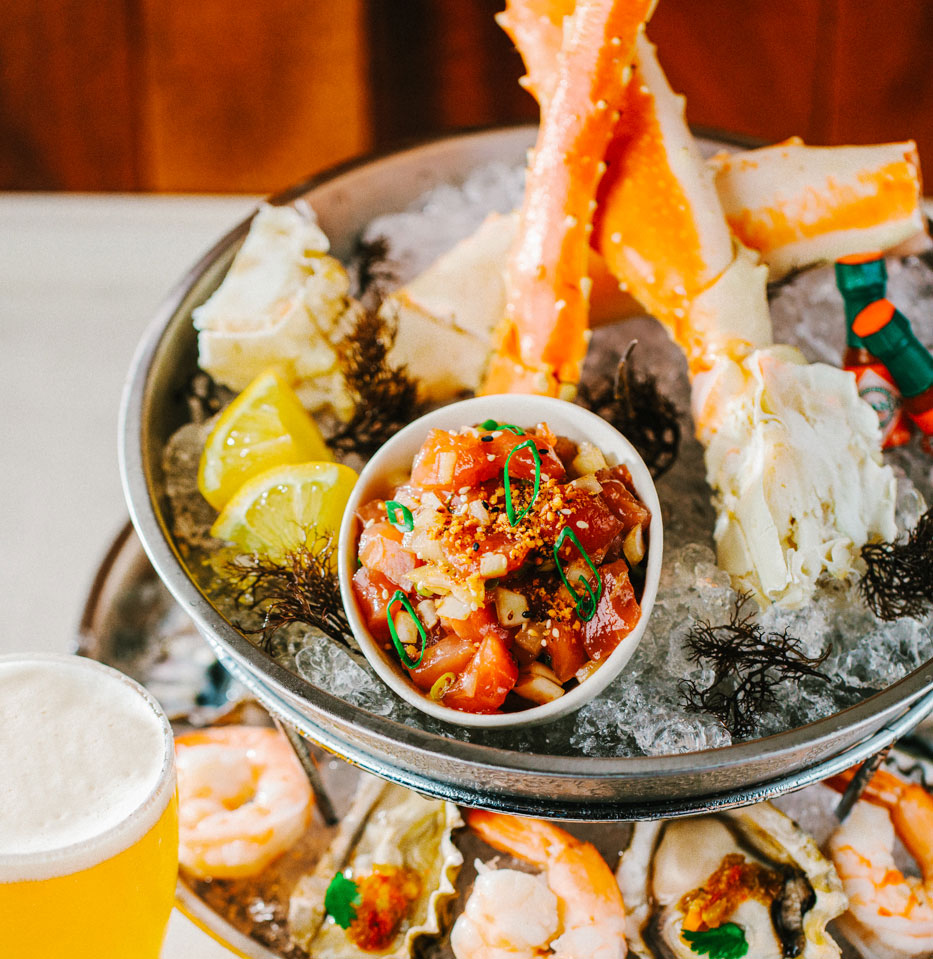 platter of seafood topped with crab